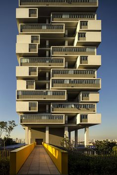 360° Building - São Paulo, Brazil, by Isay Weinfeld.  This building is comprised of 20 floors and 62 separate homes and terraces stacked up like apartments.