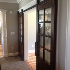 For the sunroom door.  barn door hardware - Beautiful interior sliding doors bring a rich and elegant feel to the room.  The sliding doors have a smooth silent  gl...