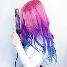 This majestic hair color plus luscious waves is PERFECTION ! @kaylahadlington is killing it in the hair game department! She used the 32mm barrel from the Titan 3 set to get these picture perfect waves ! #hairoftheday #NuMeStyle #mermaidhair #unicornhair