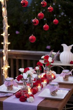 Hanging ornaments from ceiling or lights and placing on table.  Fab!