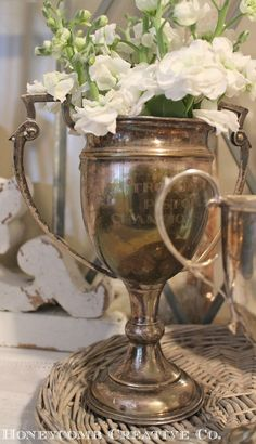 Trophies and flowers.so lovely. This is a nice way to display my grandfathers golf trophies. French Country Decorating, French Decor, Vintage Silver, Antique Silver, Silver Trays, Silver Plate, Tarnished Silver, Mason Jar Wine Glass, Vintage Decor
