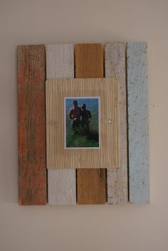 Distressed wood frame reclaimed wood frame by Adamzoriginals.  I LOVE these frames!  We have three in our house.  The picture doesn't do them justice, as they look more beautiful in person.