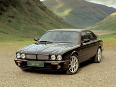 Jaguar XJ-R (X308) from 1997. The car was powered by V engines, replacing the straight six cylinder engine. The R with a supercharged V8 engine