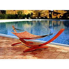 @Overstock.com - Enrich your outdoor decor with this arc hammock stand Incredible piece of furniture is inspired by a Viking boat design Durable stand is made of 100-percent high-grade FSC Certified Asia Pacific mahoganyhttp://www.overstock.com/Home-Garden/Wood-Arc-Hammock-Stand/3379757/product.html?CID=214117 $329.99