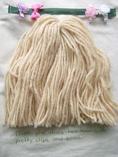 Quiet book craft, use yarn and barrettes to practise doing hair as one of the pages.