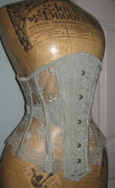 shapingcontours:    Sheer corset in lace and antique moire silk by Wyte Phantom (via Wyte Phantom)  I like the transparency in the corset to wear over a nice fabric…but I also like the dress form a lot! I would love to collect old dress forms, but I don't really have the room to do that. I might get 2 or 3.   In January I saw a gorgeous dress form made of leather in a department store. It seemed to belong to a certain line of clothing. I want one of those soooo bad!