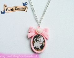 Marie from Aristocats necklace. Ava wants her bday party to be Marie themed...