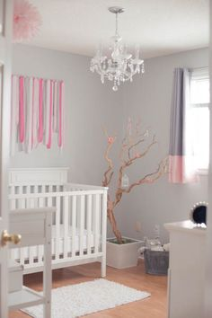 Obsessed with this manzanita tree (upcycled from this couple's wedding!) artfully placed in the corner of the nursery. #pinkandgraynursery #nurserydiy