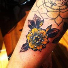 black grey and yellow same kid of flower and colors i want around my sugar skull cat tattoo
