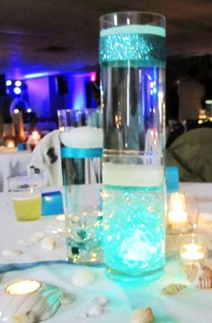 differing shades of teal, aqua & turqouise represented the colors of the sea for this beach themed wedding reception