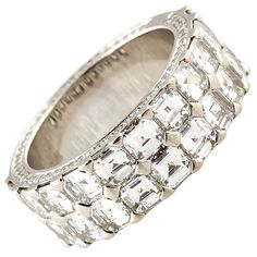 CHOPARD 'Ice Cube' Diamond 18k White Gold Band. The reverse side features 267 round brilliant cut diamonds, set in micro pavé, for a total of 1.0cts. The larger square step cut diamonds set in the front are 22 in total for 4.22cts total weight and of the finest color, cut and clarity.