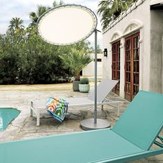 Shop sun shade.   Scaled just right for small urban outdoor spaces, personal sun shade keeps rays at bay, any place you lounge.  Grey powdercoated steel frame tilts and angles right where you need it.