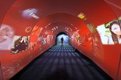 The entryway for the New York event was a tunnel filled with smoke, projections, and audio. The sounds and images...