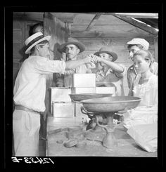 Vintage photograph of Puerto Rico  Title: Interior of country store in the hills. Puerto Rico  Creator(s): Rosskam, Edwin, 1903-, photographer  Date Created/Published: 1938 Jan.