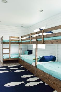 This fun ocean-themed beach house bunk room is the perfect vacation sleepover and play room for the kids. The Ikea MYDAL bunk beds have ladders and built-in storage. Beach House Bedroom, Beach House Decor, Home Bedroom, Home Decor, Girls Bedroom, Small Beach Houses, Modern Bunk Beds, Bunk Rooms, Bunk Bed Designs