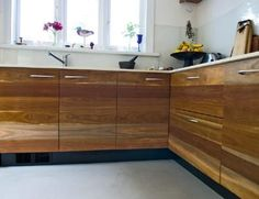 Lacquer wood grain finish on kitchen cabinets.