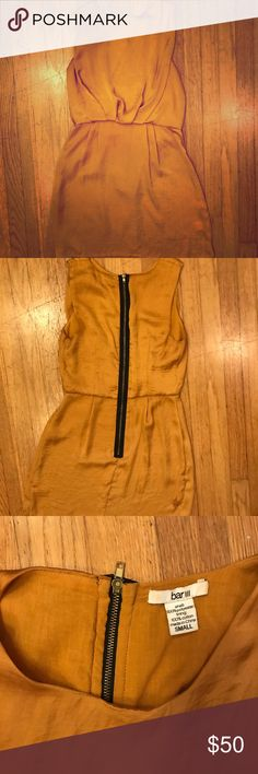 Gold Bar     Dress Barely worn, gold dress with black and gold zipper, fitted wasted with billowing bust. Hits mid thigh on my 5'4 frame. Bar III Dresses Mini
