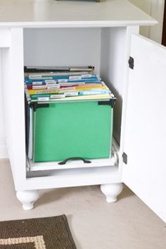 DIY File Cabinet- out of the tower portion of a older desk. Awesome use of that space.