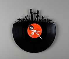 old vinyl transformed into a clock. my sister would love this!