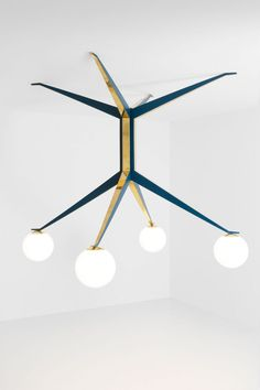 LAMPADA 045DIMORESTUDIO, PROGETTO NON FINITO2015Ceiling lamp in matte blue painted brass and polished brass.Opal glass spheres.w.210 x d.210 x h.180 cm