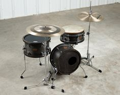 """Parish Drum Designs 3 piece Border Series Kit. Compact, quiet, extremely lightweight & portable. Perfect for acoustic music sets, churches, coffee shops, and smaller venues. Versatile enough for full band shows and other musical environments as well. Keep stage volume to a minimum, lose the drum shield, take control of your sound. Handmade in the USA using all maple shells and maple hoops. Bass Drum 8"""" x 14"""", djembe snare drum 6.5"""" x 13"""", floor tom 8"""" x 14"""""""