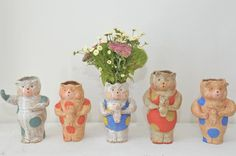 Polka dot primative folk art bear planters.