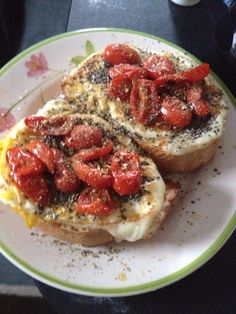 French bread, buttery crusted side, mozerella cheese, egg, fried sweet cherry tomatoes, salt, pepper, oregano, and chia seeds