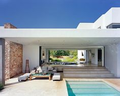 Love modern architecture of Ibiza, Spain. Juxtaposition of natural stone & white render. Blending of indoor/outdoor living. Travertine or polished concrete around pool.