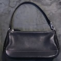 Small Black Authentic Coach Bag Cute little black bag.  Good condition.  Tag missing. Coach Bags Mini Bags