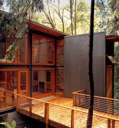 My next house will be a modern space with lots of wood and glass, surrounded by nature.