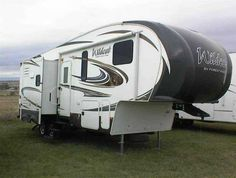 2014 Used Forest River WCF303BHX WILDCAT Fifth Wheel in Kansas KS.Recreational Vehicle, rv, 2014 Forest River WCF303BHX WILDCAT NICE FIFTH WHEEL WITH BUNKS AND QUEEN BED-CAN SLEEP UP TO 7-USED VERY LITTLE! The 303 BHX offers a triple bunk room in back, queen bed up front, huge party dinette with two removable tables and built in bed for two. This fifth wheel was used very little by the previous owner. Features include outside kitchen with 2 cook units, 50 amp electric service with 2nd A/C…
