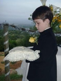 Aiden, the ring-bearer, looking seriously... well serious!