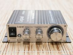 The Lepai LP-2020A+ is incredibly capable, in spite of its ~$20 price. It produces great sound and is tiny enough to tuck out of sight. We connect a bluetooth dongle and our living room tv with great results, driving a pair of large floor standing speakers.
