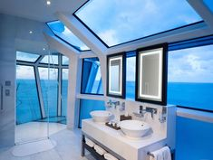 This beautiful blue and white bathroom is filled with skylights and windows that provide a gorgeous view of the water. Would you use this shower? Source: http://www.zillow.com/digs/Home-Stratosphere-boards/Luxury-Bathrooms/