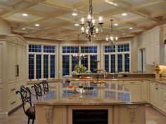 Elegant Long Island Kitchen Design For A Large Scale Room That cabinet to the left is a refrigerator!!!! awesome.
