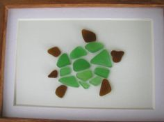 Sea Glass Turtle Mosaic - Several pieces of authentic sea glass was used to create this turtle mosaic. It sits in a 5 x 7 wooden picture frame.
