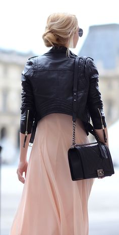 Henar Vicente is wearing a leather jacket from River Island, dress from Asos and the bag from Chanel - www.poshmap.com