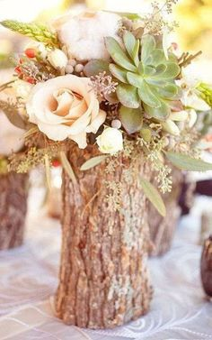 """Tree stump """"vases"""" filled with flowers as a wedding centerpiece. #diy #rustic #wedding #table"""