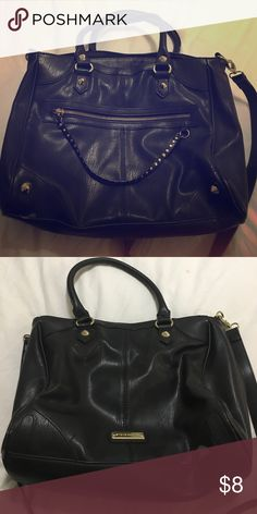 Steve Madden black bag Steve Madden leather like bag with edgy details ! Bag is showing some wear / peeling as shown in picture therefore the price low . Steve Madden Bags Shoulder Bags
