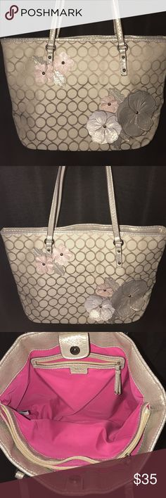 🌸beautiful NONE WEST bag🌸🌸🌸🌸 This is a very beautiful Nine West bag. It has a lot of detail on the front with pastel flowers. The inside is in great shape with its pink interior. Underneath is a pretty snakeskin look as well as straps and the side. I love this bag...  Nine West Bags Shoulder Bags