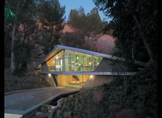 The Kimball House by Harry Gesner.   The tumbledown rocky banks are gone and the underside of the bridge is filled in, but the house still captures the beauty of the canyon, connecting its walls across space.