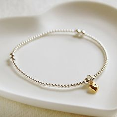 Delicate Silver Bead Bracelet With Tiny Gold Heart