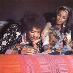 Jimi at home reading with his girlfriend (not sure who she is...but could be Lithofayne Pridgeon...??)