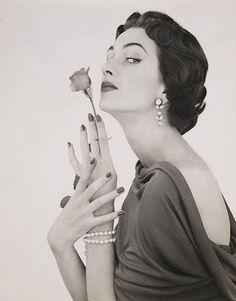 Woman with a rose - Photo by Zoltán Glass, 1960.