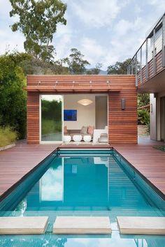 modern pool house, teak deck, long narrow swimming pool