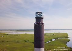 Get a bird's eye view when you climb one of the two lighthouses in NC's Brunswick Islands. The Oak Island Lighthouse (shown) was the brightest lighthouse in the US when originally constructed.  It is the last lighthouse built in North Carolina.