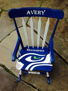 Childs Seahawks custom hand painted rocking chair. Great gift for your little Seahawks fan!  Personalized with name on back of chair.