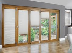 White Window Treatments On The Large Wooden Sliding Glass Doors Paired With Laminate Floor In The Beige Room: Cool Window Treatments For Sli...