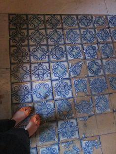 tiled floor inside the Vatican museums.