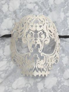 Google Image Result for http://masqueboutique.com/content/uploads/2012/09/Ivory-Metal-Filigree-Skull-Mask-1.jpg